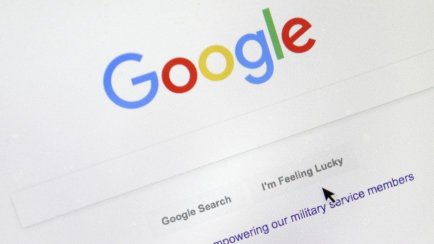 FILE - In this Aug. 28, 2018, file photo, a cursor moves over Google's search engine page, in Portland, Ore. Google is paying more attention to the small words in your searches. Google is rolling out the change to English language searches in the U.S. starting this week. (AP Photo/Don Ryan, File)