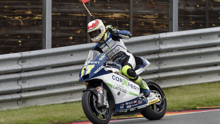Dominique Aegerter from Switzerland celebrates winning the Moto2 race at the Sachsenring circuit in Hohenstein-Ernstthal, Germany, Sunday, July 13, 2014. (AP Photo/Jens Meyer)