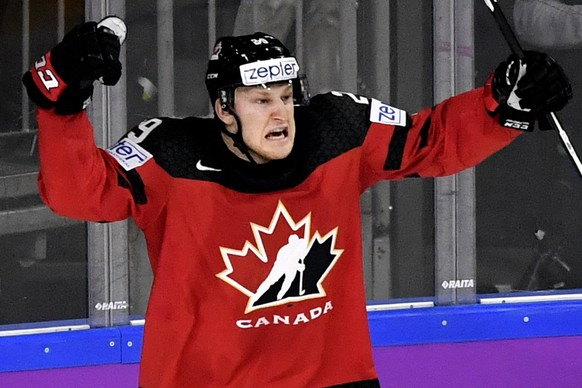 epa05976823 Canada's forward Nate Mackinnon celebrates after scoring the 2-2 equalizer during the 2017 IIHF Ice Hockey World Championship semifinal match between Canada and Russia in Cologne, Germany, 20 May 2017.  EPA/SASCHA STEINBACH
