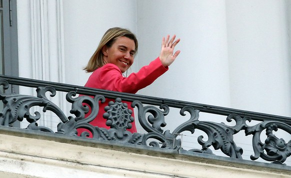 European Union High Representative Federica Mogherini waves from a balcony of the Palais Coburg where closed-door nuclear talks with Iran continue in Vienna, Austria, Monday, July 13, 2015. (AP Photo/Ronald Zak)