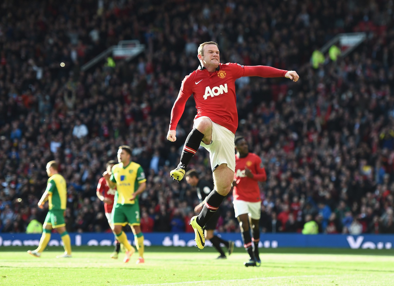 MANCHESTER, ENGLAND - APRIL 26: Wayne Rooney of Manchester United celebrates his first half penalty during the Barclays Premier League match between Manchester United and Norwich City at Old Trafford on April 26, 2014 in Manchester, England.  (Photo by Laurence Griffiths/Getty Images)