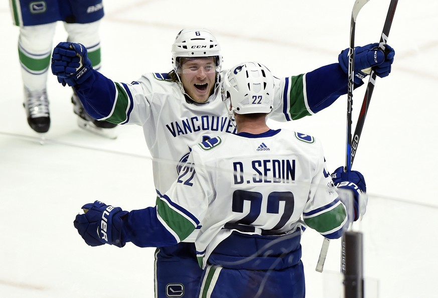 Vancouver Canucks left wing Daniel Sedin (22), of Sweden, celebrates with right wing Brock Boeser (6) after Sedin scored against the Nashville Predators,p tying the score during the third period of an NHL hockey game Thursday, Nov. 30, 2017, in Nashville, Tenn. The Canucks won 5-3. (AP Photo/Mark Zaleski)