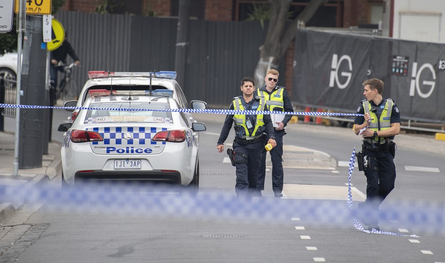 epa07505315 Victoria Police at the scene of a multiple shooting outside Love Machine nightclub in Prahran, Melbourne, Victoria, Australia, 14 April 2019. According to media reports, a man was killed and three others were injured in a drive-by shooting outside a nightclub in Melbourne. One of those shot is in a critical condition, while two have sustained non-life threatening injuries, media added. Police was quoted as saying that there was no evidence suggesting the incident as terror-related.  EPA/ELLEN SMITH  AUSTRALIA AND NEW ZEALAND OUT