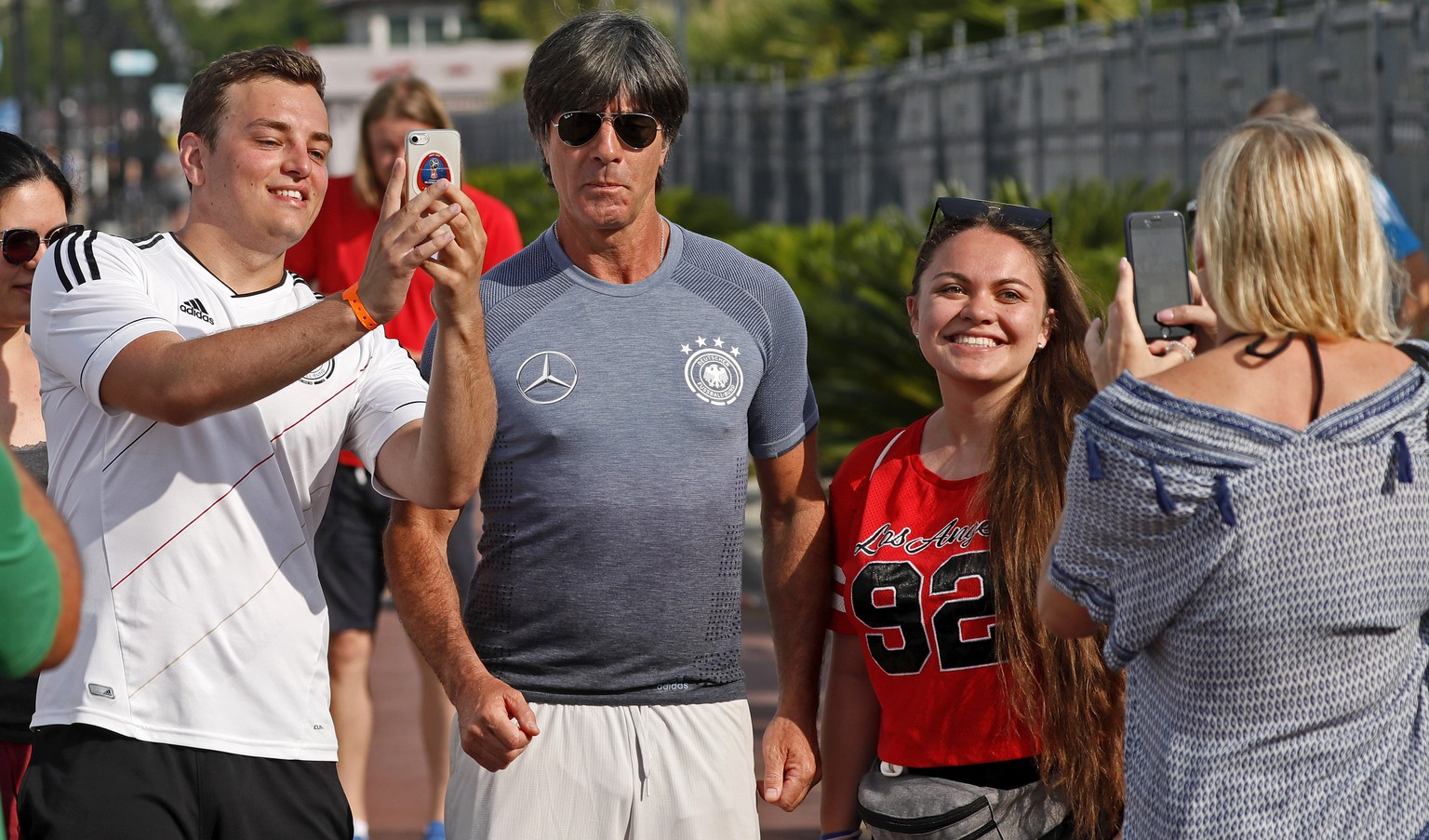 epaselect epa06829464 Germany's head coach Joachim Loew with fans in front of the hotel in Adler Sochi, Russia, 22 June 2018. Germany will face Sweden in the FIFA World Cup 2018 Group F preliminary round soccer match on 23 June 2018.  EPA/RONALD WITTEK