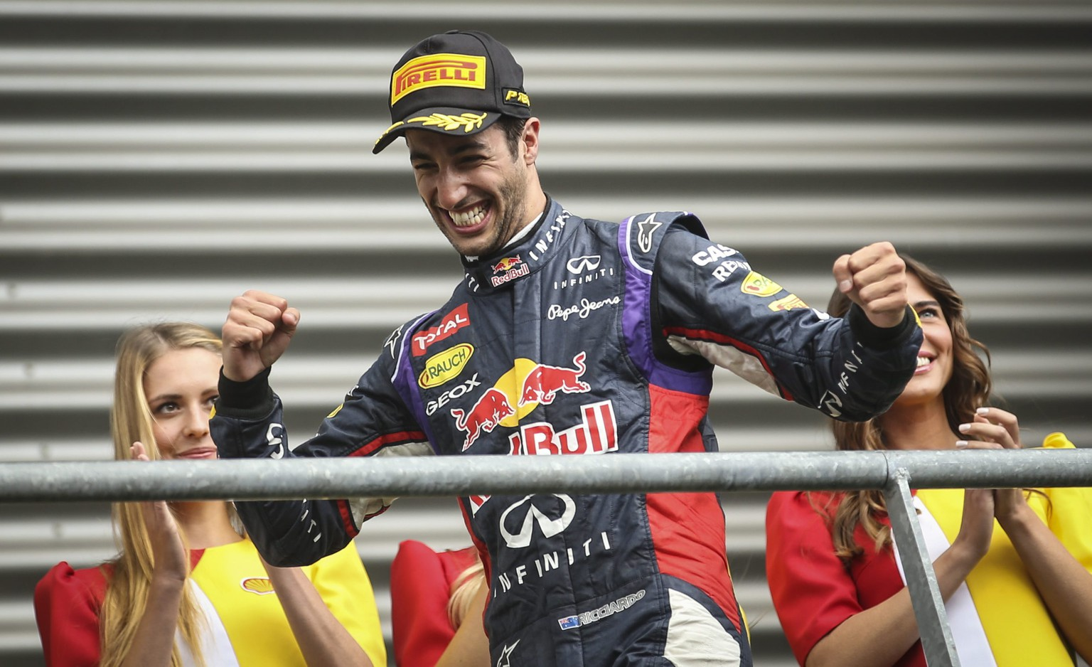 epa04366082 Australian Formula One driver Daniel Ricciardo of Red Bull Racing celebrates on the podium after winning the 2014 Belgium Formula One Grand Prix, at the Spa-Francorchamps race track near Francorchamps, Belgium, 24 August 2014.  EPA/OLIVIER HOSLET