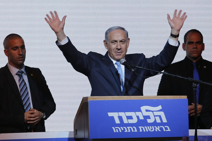 epa04667078 Israeli Prime Minister Benjamin Netanyahu waves to supporters as he delivers his speech in Tel Aviv, Israel, early 17 March 2015. Netanyahu's Likud party was set to emerge as the big winner in national elections with almost all of the ballots counted early 18 March.  EPA/ABIR SULTAN