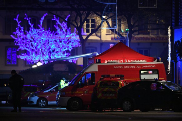 epa07224952 Authorities work at a makeshift emergency services base after a deadly shooting in Strasbourg, France, early 12 December 2018. According to the latest reports, four people were killed. According to reports, four people have been killed and more than 10 people have been injured after a deadly attack at the Christmas market in Strasbourg. The gunman is reported to be at large and the motive for the attack is still unclear.  EPA/PATRICK SEEGER