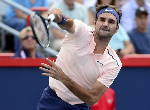 Roger Federer, of Switzerland, serves the ball to Robin Haase, of the Netherlands, during Rogers Cup tennis action, in Montreal on Saturday, Aug. 12, 2017. (Paul Chiasson/The Canadian Press via AP)