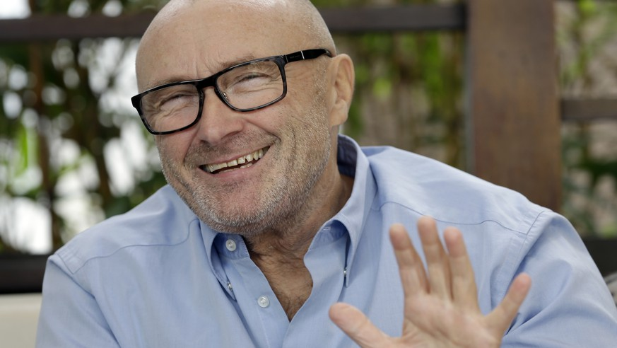 FILE - In this Dec. 4, 2013 file photo, British musician Phil Collins, smiles during an interview in Miami  Beach, Fla. State lawmakers have named pop star Phil Collins an honorary Texan, saluting his donation of hundreds of Alamo artifacts back to the historic outpost. The former Genesis singer-drummer appeared Wednesday, March 11, 2015, in the Texas Legislature. He didn't give a speech, but greeted lawmakers who crowded to shake hands. (AP Photo/Alan Diaz, File)