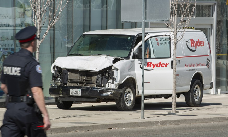 epa09048964 (FILE) - A rented van sits on a sidewalk about a mile from where several pedestrians were injured in northern Toronto, Canada, 23 April 2018 (reissued on 03 March 2021). A judge in Toronto in a hearing on 03 March 2021 has convicted the Alek Minassian, the van driver of 10 counts of first-degree murder and 16 counts of attempted murder. Ten people were killed and 16 injured on 23 April 2018, after Alek Minassian driving a rented van mowed down pedestrians along a one-mile stretch of Yonge Street.  EPA/WARREN TODA *** Local Caption *** 54284109
