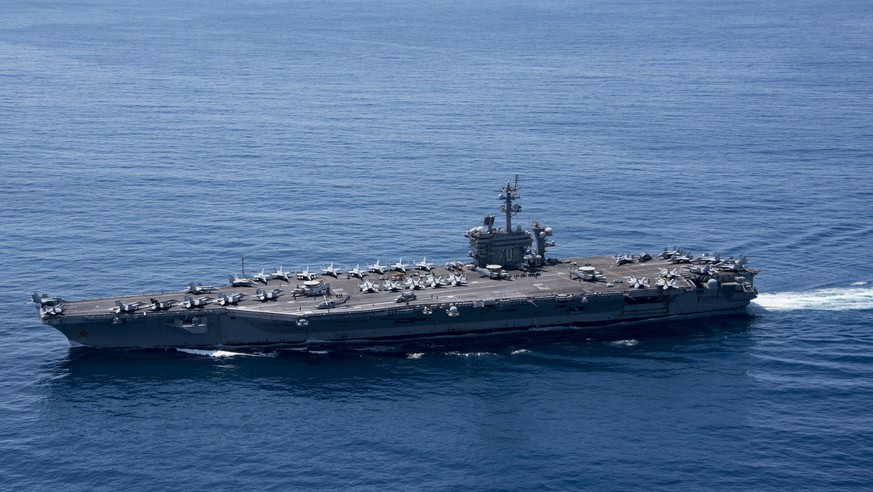 epa05913061 A handout photo made available by the US Department of Defense shows the aircraft carrier USS Carl Vinson (CVN 70) in the Indian Ocean, 15 April 2017 (issued 18 April 2017). According to media reports, the Carl Vinson US Navy Strike Group, which includes the USS Carl Vinson, is moving toward the Korean peninsula in the wake of North Korean ballistic missile tests and reported increased activity at North Korea's nuclear test site.  EPA/US DEPARTMENT OF DEFENSE HANDOUT  HANDOUT EDITORIAL USE ONLY/NO SALES
