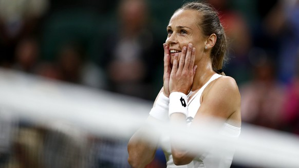 epa06081950 Magdalena Rybarikova of Slovakia celebrates winning against Coco Vandeweghe of the USA during their quarter final match for the Wimbledon Championships at the All England Lawn Tennis Club, in London, Britain, 11 July 2017.  EPA/NIC BOTHMA EDITORIAL USE ONLY/NO COMMERCIAL SALES