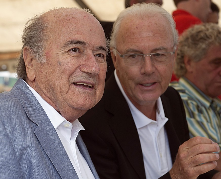 epa04988178 (FILE) FIFA President, Swiss Joseph Sepp Blatter (L) and former German soccer player Franz Beckenbauer during the Sepp Blatter Soccer Tournament in Ulrichen, Switzerland, 09 August 2014. A FIFA ethics committee investigation against German icon Franz Beckenbauer has been completed and the case is passed on to its adjudicatory chamber for a ruling, the ethics committee said on 21 October 2015. The ethics committee also said it will do its best to come to a final decision in its probe against FIFA president Joseph Blatter and Platini before the end of their provisional 90-day suspension.  EPA/ANTHONY ANEX