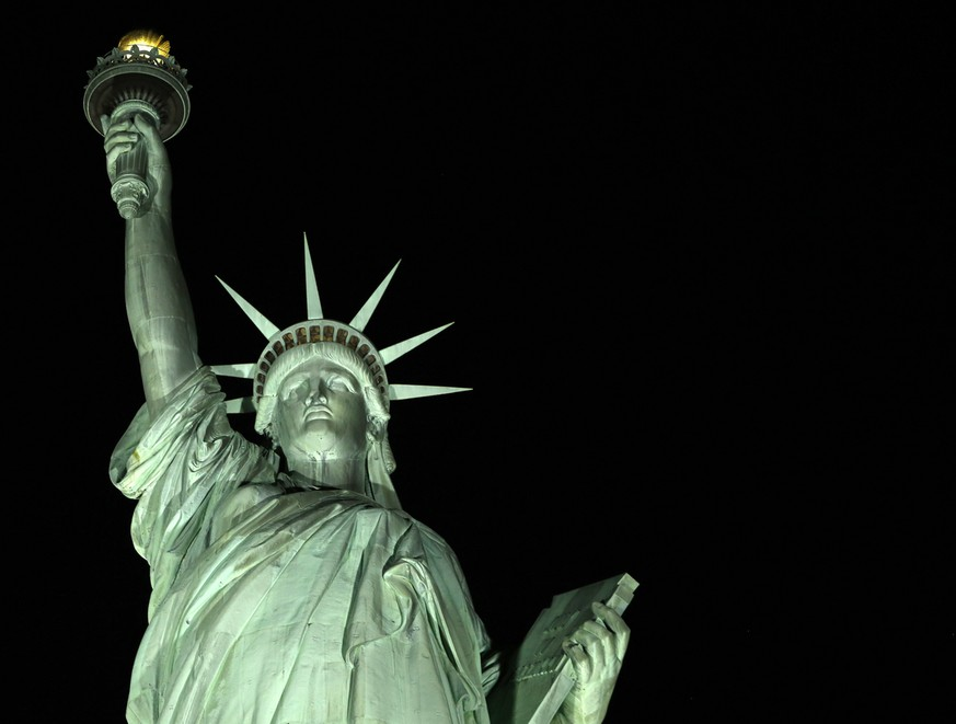 New light-emitting diodes or LEDs illuminate the Statue of Liberty on Liberty Island after the new system was turned on in New York, Tuesday, July 7, 2015. The system comes from Musco Lighting of Oskaloosa, Iowa. Musco systems are also in place at the Washington Monument, the White House and the Flight 93 National Memorial. (AP Photo/Kathy Willens)