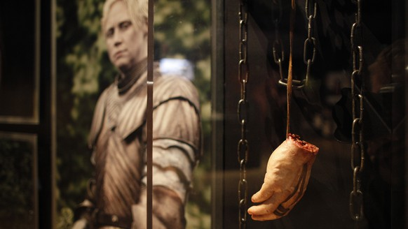 Jaime Lannister's Shackles and Severed hand stand on display at the Game of Thrones Exhibition at the Waterfront Hall, Belfast, Northern Ireland, Tuesday, June  10, 2014. The Game of Thrones Exhibition, on the smash hit TV series, is a collection of nearly 100 original artifacts from pivotal scenes in Seasons 1,2 and 3 plus select pieces from the fourth season. (AP Photo/Peter Morrison)