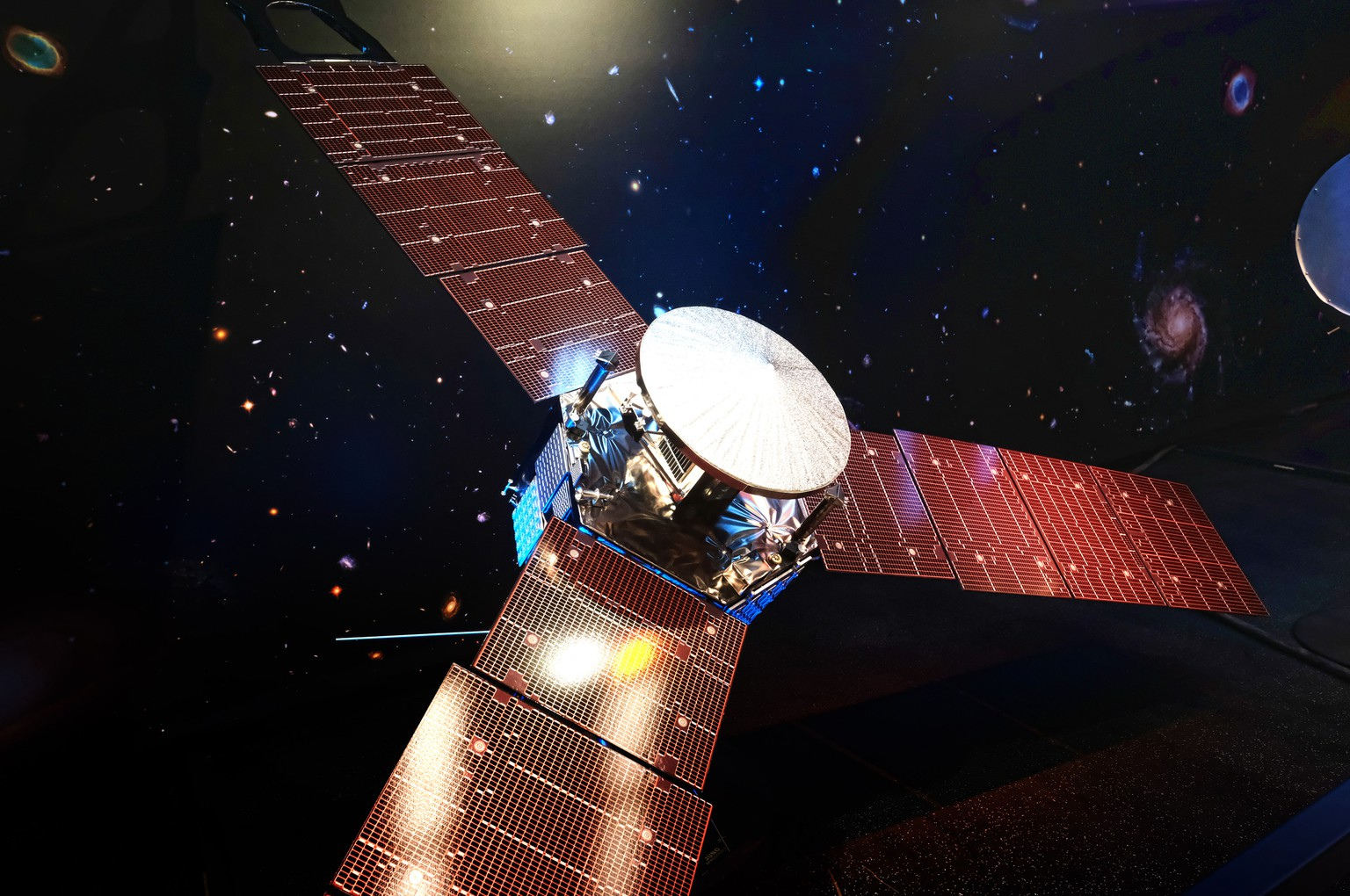 A 1/5 scale model size of NASA's solar-powered Juno spacecraft is displayed at the Jet Propulsion Laboratory in Pasadena, Calif. on Friday, July 1, 2016. The spacecraft is on the final leg of a five-year, 1.8 billion-mile voyage to the biggest planet in the solar system. It's expected to reach Jupiter and go into orbit around the planet on July 4. (AP Photo/Richard Vogel)