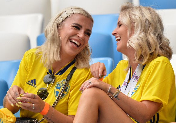 epa06870817 Josefin Johnsson (L), the wife of Sweden's Mikael Lustig and Tina Loonberg, the girlfriend of Sweden's Sebastian Larsson before the FIFA World Cup 2018 quarter final soccer match between Sweden and England in Samara, Russia, 07 July 2018.