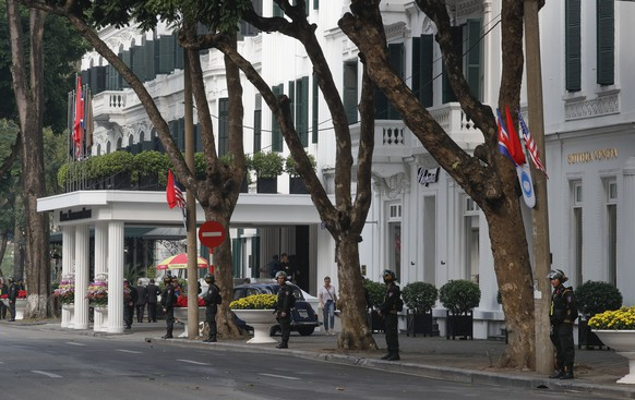 epa07400295 Security personnel stand guard in front of Sofitel Legend Metropole Hanoi hotel, where the US President and the North Korean leader are expected to meet for the second US-North Korea summit, in Hanoi, Vietnam, 27 February 2019. The second meeting of the US President Trump and the North Korean leader Kim, running from 27 to 28 February 2019, focuses on furthering steps towards achieving peace and complete denuclearization of the Korean peninsula.  EPA/WALLACE WOON