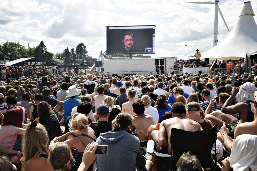 Whistleblower Edward Snowden of the US, speaks to the crowd on a gigant screen at the Roskilde Festival in Roskilde, Denmark, Tuesday, June 28. 2016.
