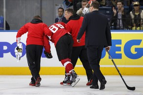Switzerland's Kevin Romy is escorted by Swiss medical staff after a clash, during the 2014 IIHF Ice Hockey World Championships preliminary round game Switzerland vs Kazakhstan, at the Minsk Arena, in Minsk, Belarus, Saturday, May 17, 2014. (KEYSTONE/Salvatore Di Nolfi)