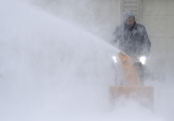 David Liebhard fights windy conditions as he snow blows his driveway Monday, Jan. 28, 2019, in Appleton, Wis. Heavy snow and gusting winds created blizzard-like conditions Monday across the Upper Midwest, prompting officials to close hundreds of schools, courthouses and businesses, and ground air travel. (Dan Powers/The Post-Crescent via AP)