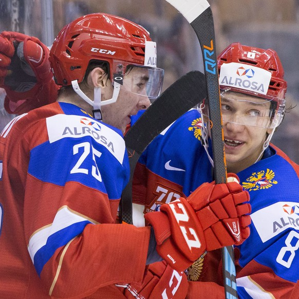 Russia's Yakov Trenin, left, celebrates his goal against Slovakia with Kirill Urakov during the third period of a world junior championship hockey game in Toronto on Saturday, Dec. 31, 2016. (Chris Young/The Canadian Press via AP)