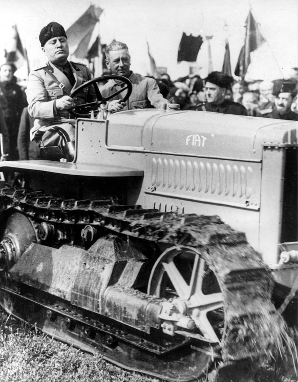 Italy's Premier Benito Mussolini operates a tractor plow as he officiates at the founding new City of Aprilia on the site of former wasteland at the Pontine marshes in Italy, April 1935.  (KEYSTONE/AP Photo/Str)