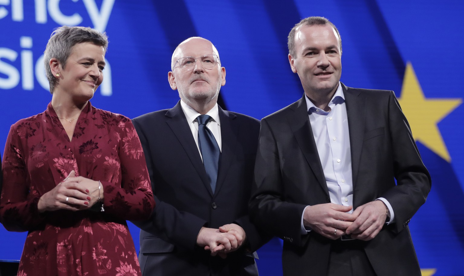 epa07573504 (L-R) Danish Margrethe Vestager of the Alliance of Liberals and Democrats for Europe (ALDE), Dutch Frans Timmermans of the Party of European Socialists (PES), German Manfred Weber of European People's Party (EPP), all candidates for the next president of the European Commission, pose ahead of the Eurovision presidential debate at European parliament in Brussels, Belgium, 15 May 2019. The 2019 Eurovision Presidential Debate will be broadcast live at 21:00 CEST.  EPA/OLIVIER HOSLET