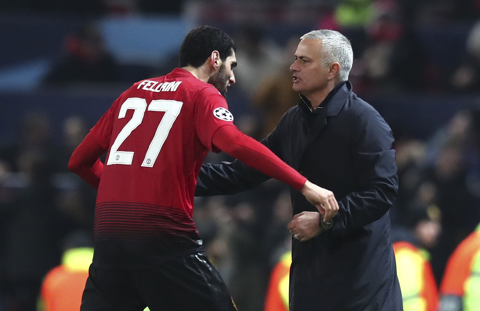 ManU midfielder Marouane Fellaini celebrates with ManU coach Jose Mourinho after scoring the opening goal during the Champions League group H soccer match between Manchester United and Young Boys at Old Trafford Stadium in Manchester, England, Tuesday Nov. 27, 2018. (AP Photo/Jon Super)