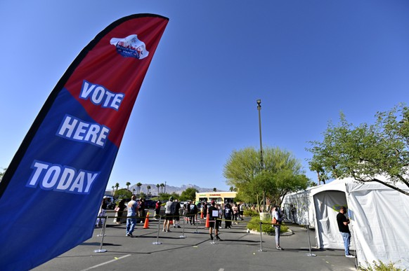 epa08796471 Voters wait in line to cast their ballot at a tented voting station in Las Vegas, Nevada, USA, 03 November 2020. Americans vote on Election Day to choose between re-electing Donald J. Trump or electing Joe Biden as the 46th President of the United States to serve from 2021 through 2024.  EPA/DAVID BECKER
