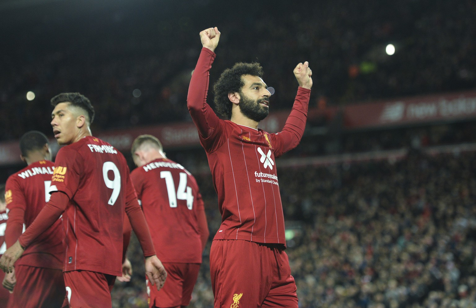epa07954460 Liverpool's Mohamed Salah celebrates after scoring the 2-1 goal during the English Premier League game between Liverpool FC and Tottenham Hotspur in Liverpool, Britain, 27 October 2019.  EPA/PETER POWELL EDITORIAL USE ONLY. No use with unauthorized audio, video, data, fixture lists, club/league logos or 'live' services. Online in-match use limited to 120 images, no video emulation. No use in betting, games or single club/league/player publications.