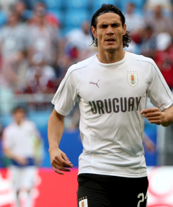 epa06838799 Edinson Cavani of Uruguay of Uruguay warms up prior to the FIFA World Cup 2018 group A preliminary round soccer match between Uruguay and Russia in Samara, Russia, 25 June 2018.  (RESTRICTIONS APPLY: Editorial Use Only, not used in association with any commercial entity - Images must not be used in any form of alert service or push service of any kind including via mobile alert services, downloads to mobile devices or MMS messaging - Images must appear as still images and must not emulate match action video footage - No alteration is made to, and no text or image is superimposed over, any published image which: (a) intentionally obscures or removes a sponsor identification image; or (b) adds or overlays the commercial identification of any third party which is not officially associated with the FIFA World Cup)  EPA/WALLACE WOON   EDITORIAL USE ONLY
