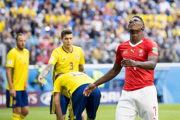 Switzerland's forward Breel Embolo, right, reacts during the FIFA World Cup 2018 round of 16 soccer match between Sweden and Switzerland at the Krestovski Stadium, in St. Petersburg, Russia, Tuesday, July 3, 2018. (KEYSTONE/Laurent Gillieron)