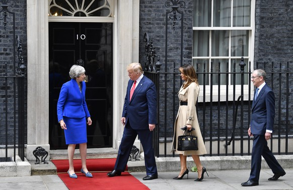 epa07624138 US President Donald J. Trump (2-L) and his wife US First Lady Melania Trump (2-R) are welcomed by Britain's Prime Minister Theresa May (L) and her husband Philip May (R) at her official residence at 10 Downing Street in London, Britain, 04 June 2019. US President Trump and his wife are on a three-day official visit to Britain.  EPA/NEIL HALL
