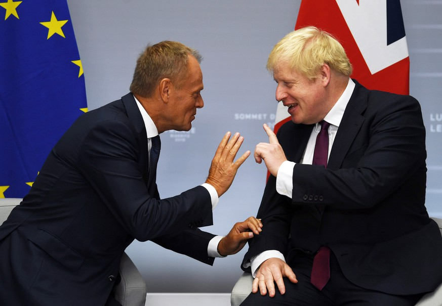 epaselect epa07792318 Britain's Prime Minister Boris Johnson (R) meets European Union Council President Donald Tusk (L) for their bilateral talks during the G7 summit in Biarritz, France, 25 August 2019. The G7 Summit runs from 24 to 26 August in Biarritz.  EPA/NEIL HALL / POOL