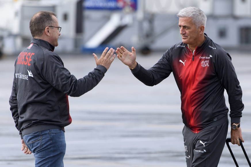 Switzerland's national soccer team head coach Vladimir Petkovic, right, cheers with chief press officer of the Swiss soccer federation Marco Von Ah, left, after getting off the Swiss International Air Lines plane after landing at the Samara Airport, in Samara, Russia, Monday, June 11, 2018. The Swiss national soccer team for the 2018 Fifa World Cup in Russia, is based in Togliatti in the Samara district. (KEYSTONE/Laurent Gillieron)