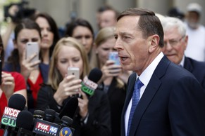 Former CIA Director David Petraeus leaves the federal courthouse in Charlotte, N.C., Thursday, April 23, 2015 after pleading guilty to sharing top government secrets with his biographer. Petraeus, whose career was destroyed by an extramarital affair with his biographer, was sentenced Thursday to two years' probation and fined $100,000 for giving her classified material while she was working on the book. (AP Photo/Chuck Burton)