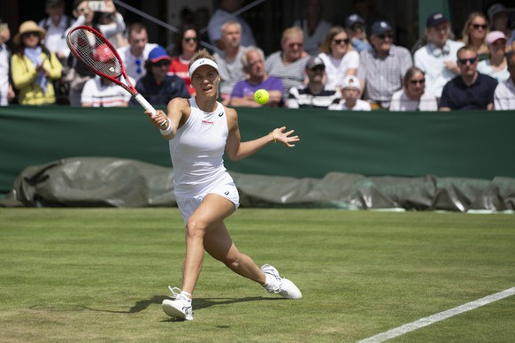 Viktorija Golubic of Switzerland in action during her first round match against Iga Swiatek of Poland, at the All England Lawn Tennis Championships in Wimbledon, London, on Monday, July 1, 2019.(KEYSTONE/Peter Klaunzer) .