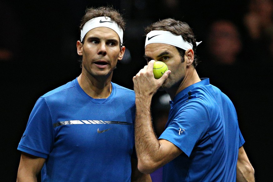 epa06222856 Switzerland's Roger Federer (R) and Spanish Rafael Nadal (L) of the Team Europe in action during the Laver Cup tennis tournament in Prague, Czech Republic, 23 September 2017. The first Laver Cup is held in Prague, Czech Republic, from 22 to 24 September 2017. It is a three-day tournament pitting a team of the six best tennis players from Europe against six opponents from the rest of the world. The tournament has been named in honor of Australian tennis legend Rod Laver.  EPA/MILAN KAMMERMAYER