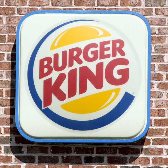 epa04369397 A Burger King restaurant in Alexandria, Virginia, USA, 26 August 2014.  Burger King is buying the Canadian doughnut chain Tim Hortons for 11 billion dollars, the US company said 26 August. Burger King said the two companies would continue to operate under their own brands and have separate management. The two firms will have 18,000 restaurants in 100 countries and an annual turnover of about 23 billion dollars.  EPA/MICHAEL REYNOLDS