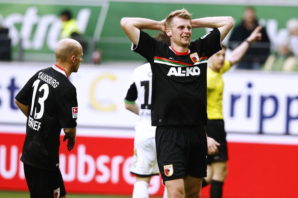 WOLFSBURG, GERMANY - MARCH 22: Jan Ingwer Callsen Bracker of Augsburg  appears frustrated during the Bundesliga match between and VfL Wolfsburg and FC Augsburg at Volkswagen Arena on March 22, 2014 in Wolfsburg, Germany.  (Photo by Oliver Hardt/Bongarts/Getty Images)