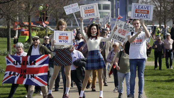 """Pro-Brexit leave the European Union supporters pose for photos as they take part in the final leg of the """"March to Leave"""" in London, Friday, March 29, 2019. The protest march which started on March 16 in Sunderland, north east England, finishes on Friday March 29 in Parliament Square, London, on what was the original date for Brexit to happen before the recent extension. (AP Photo/Matt Dunham)"""