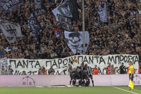 The players of Greece's PAOK FC cheer after scoring during the UEFA Champions League second qualifying round first leg match between Greece's PAOK FC and Switzerland's FC Basel 1893 in the Toumba stadium in Thessaloniki, Greece, on Tuesday, July 24, 2018. (KEYSTONE/Georgios Kefalas)