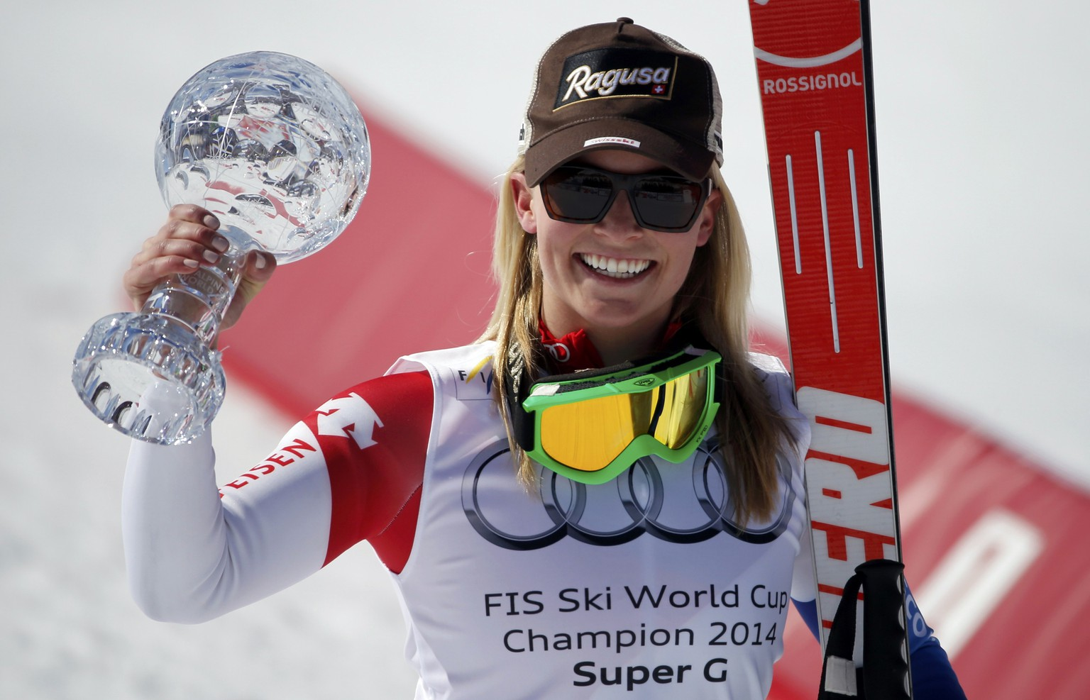 Lara Gut of Switzerland celebrates with the trophy after winning the overall women's Super G competition during the FIS Alpine Skiing World Cup finals in the Swiss ski resort of Lenzerheide March 13, 2014. REUTERS/Leonhard Foeger (SWITZERLAND  - Tags: SPORT SKIING)