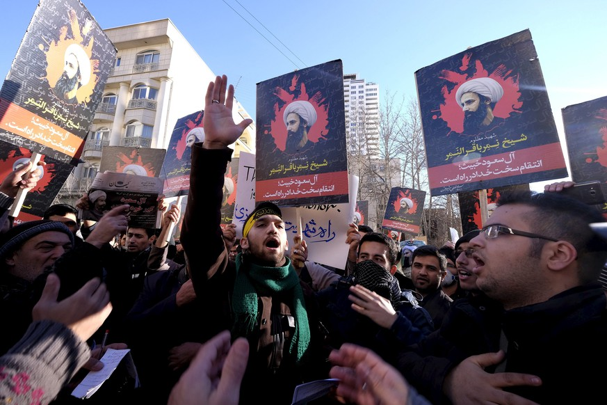 Iranian protesters chant slogans as they hold pictures of Shi'ite cleric Sheikh Nimr al-Nimr during a demonstration against the execution of Nimr in Saudi Arabia, outside the Saudi Arabian Embassy in Tehran January, 3, 2016. REUTERS/Raheb Homavandi/TIMA  ATTENTION EDITORS - THIS IMAGE WAS PROVIDED BY A THIRD PARTY. FOR EDITORIAL USE ONLY.