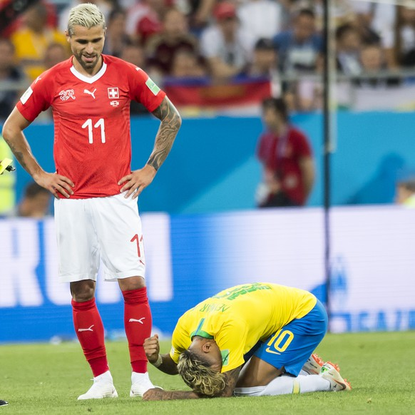 Brazil's midfielder Philippe Coutinho, left, Switzerland's midfielder Valon Behrami, center, react next to Brazil's forward Neymar, right, during the FIFA soccer World Cup 2018 group E match between Switzerland and Brazil at the Rostov Arena, in Rostov-on-Don, Russia, Sunday, June 17, 2018. (KEYSTONE/Laurent Gillieron)