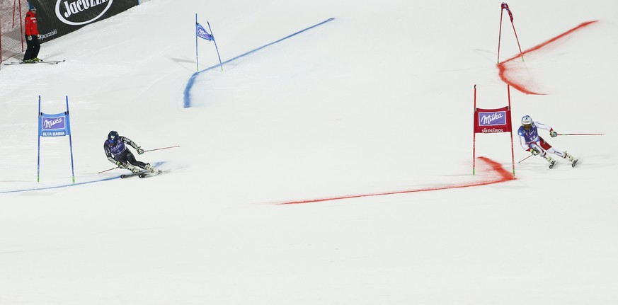 France's Mathieu Faivre , left, and Switzerland's Gino Caviezel compete during an alpine ski, men's World Cup parallel giant slalom, in Alta Badia Italy, Monday, Dec. 19, 2016. (AP Photo/Gabriele Facciotti)