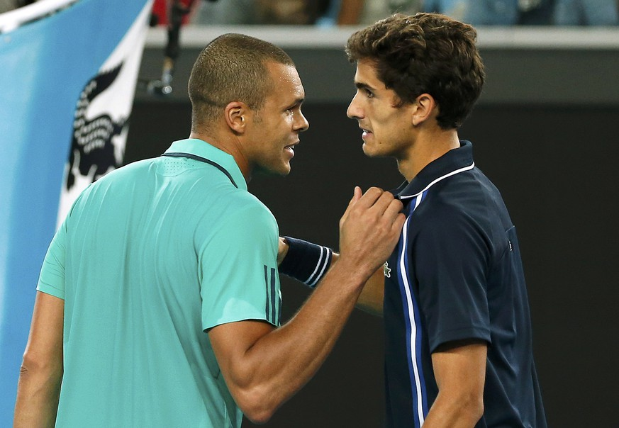 France's Jo-Wilfried Tsonga (L) speaks with compatriot Pierre-Hugues Herbert after Tsonga won their third round match at the Australian Open tennis tournament at Melbourne Park, Australia, January 22, 2016. REUTERS/Issei Kato