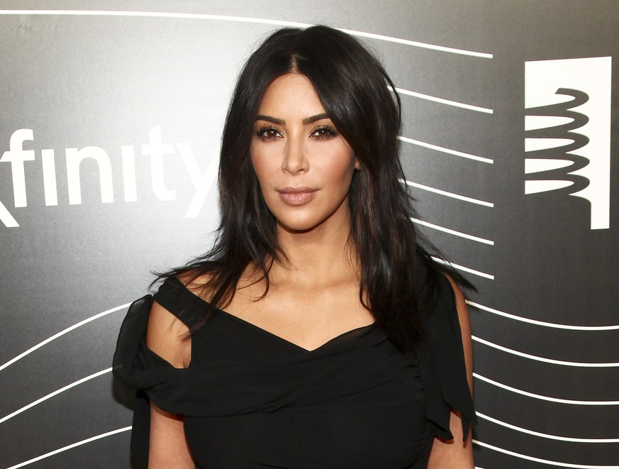 FILE - In this May 16, 2016 file photo, Kim Kardashian West attends the 20th Annual Webby Awards in New York. Kardashian who has been laying low in a New York City apartment building since her robbery at gunpoint in Paris in October, breaks her silence in a new teaser for the family's reality show,