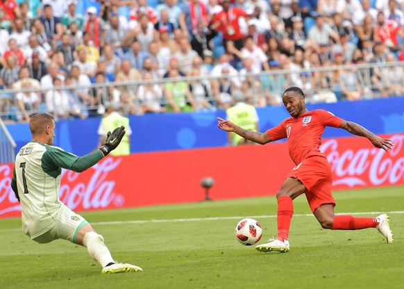 epa06871312 Goalkeeper Robin Olsen (L) of Sweden and Raheem Sterling of England in action during the FIFA World Cup 2018 quarter final soccer match between Sweden and England in Samara, Russia, 07 July 2018.  (RESTRICTIONS APPLY: Editorial Use Only, not used in association with any commercial entity - Images must not be used in any form of alert service or push service of any kind including via mobile alert services, downloads to mobile devices or MMS messaging - Images must appear as still images and must not emulate match action video footage - No alteration is made to, and no text or image is superimposed over, any published image which: (a) intentionally obscures or removes a sponsor identification image; or (b) adds or overlays the commercial identification of any third party which is not officially associated with the FIFA World Cup)  EPA/PETER POWELL   EDITORIAL USE ONLY